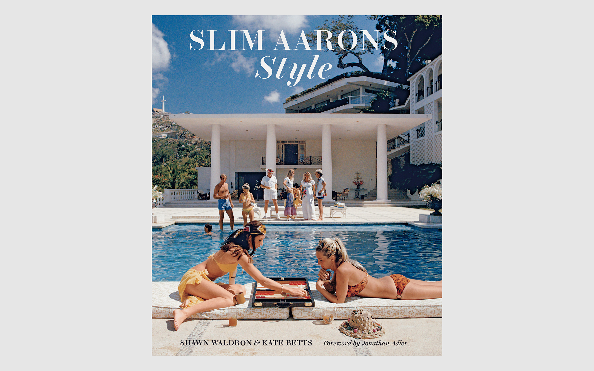 The cover of Slim Aarons: Style, the latest chapter of books featuring the lost world Aarons captured. It features women in bikinis lounging by a pool