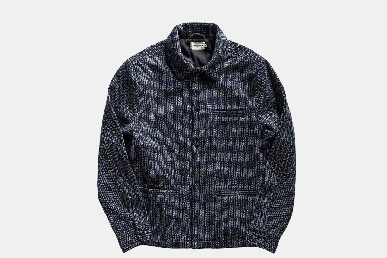 a knit, navy jacket