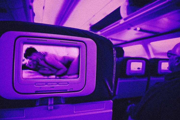 Intimate scene between a man and woman plays on an airplane headrest screen
