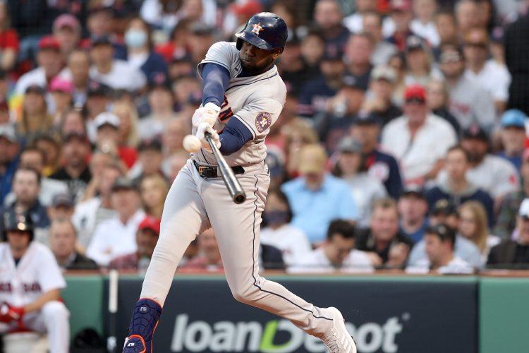 Yordan Alvarez of the Houston Astros hits a home run against the Boston Red Sox