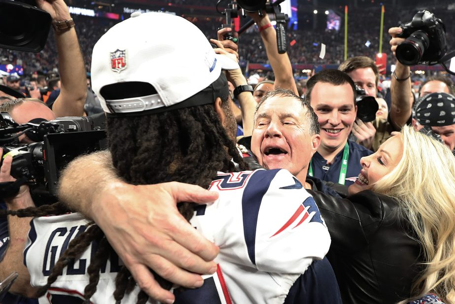 Patriots head coach Bill Belichick and Linda Holliday celebrate with Stephon Gilmore