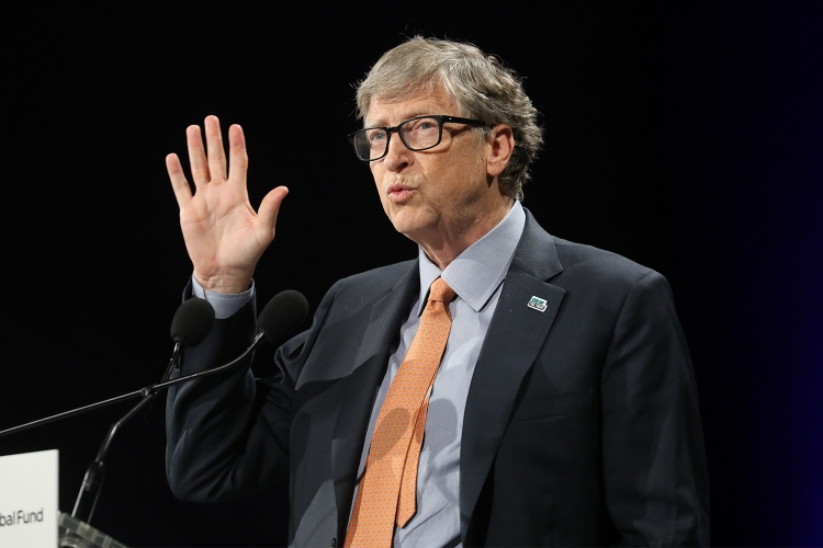 Bill Gates with a suit and tie at a lectern speaking in October 2019 in Lyon, France