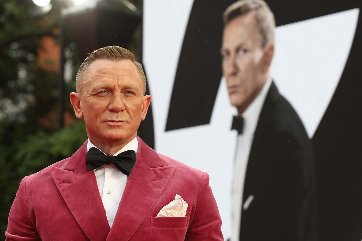 """Daniel Craig attends the World Premiere of """"NO TIME TO DIE"""" at the Royal Albert Hall on September 28, 2021 in London, England. The """"No Time to Die"""" actor recently admitted he likes a vodka and soda as his preferred cocktail."""