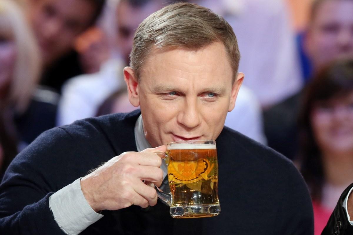 James Bond actor Daniel Craig sipping a beer