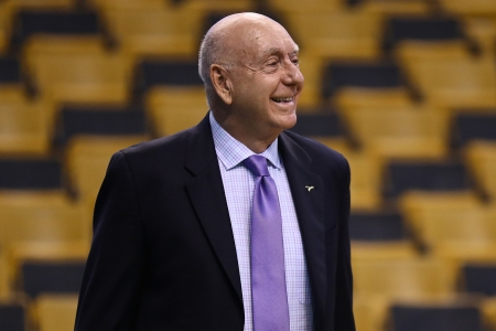 Sportscaster Dick Vitale in 2018 dressed in a suit with a purple tie before a game between the Boston Celtics and the LA Clippers at TD Garden.