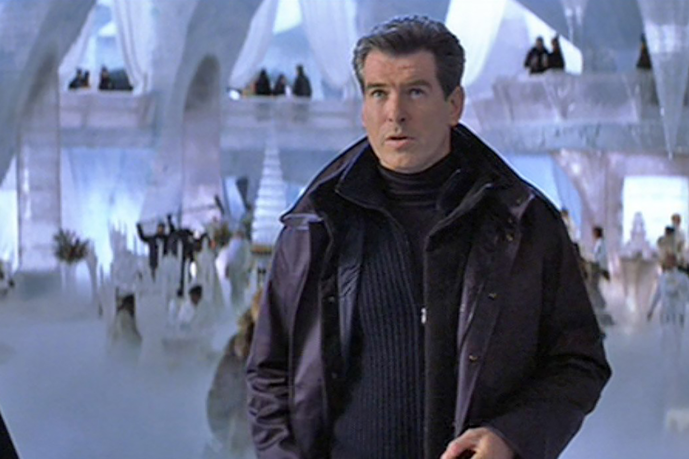 Brosnan layers a winter coat, a half zip sweater and a turtleneck in Die Another Day.