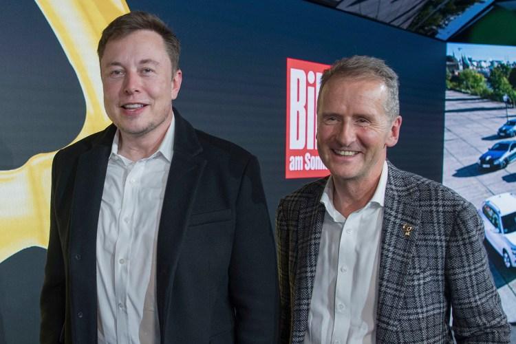 Tesla CEO Elon Musk (left) with Volkswagen CEO Herbert Diess in Berlin in 2019