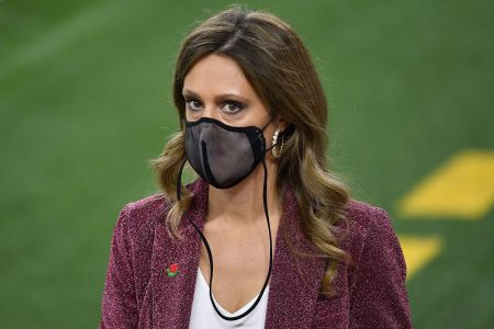 Sideline reporter Allison Williams wearing a face mask during the College Football Playoff Semifinal in 2021