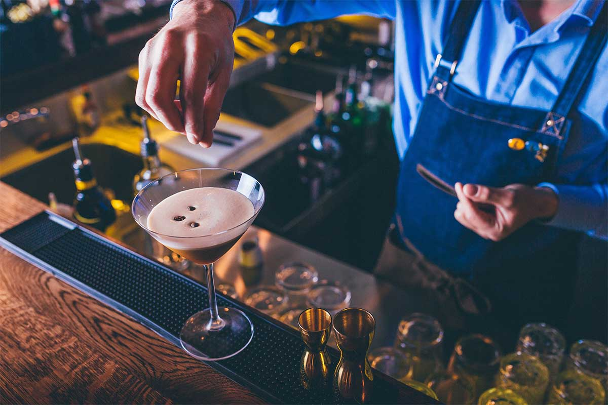 A barista/bartender prepping an espresso martini. The '90s drink staple has made a return, to the regret of some bartenders.