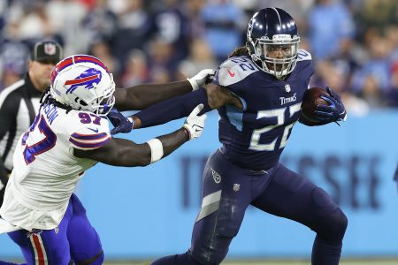 Derrick Henry of the Tennessee Titans rushes past defensive end Mario Addison. Henry had the fastest TD run of the season on Monday night