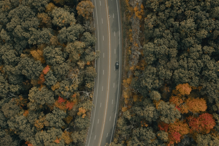 A car drives north through the Hudson Valley in Upstate New York