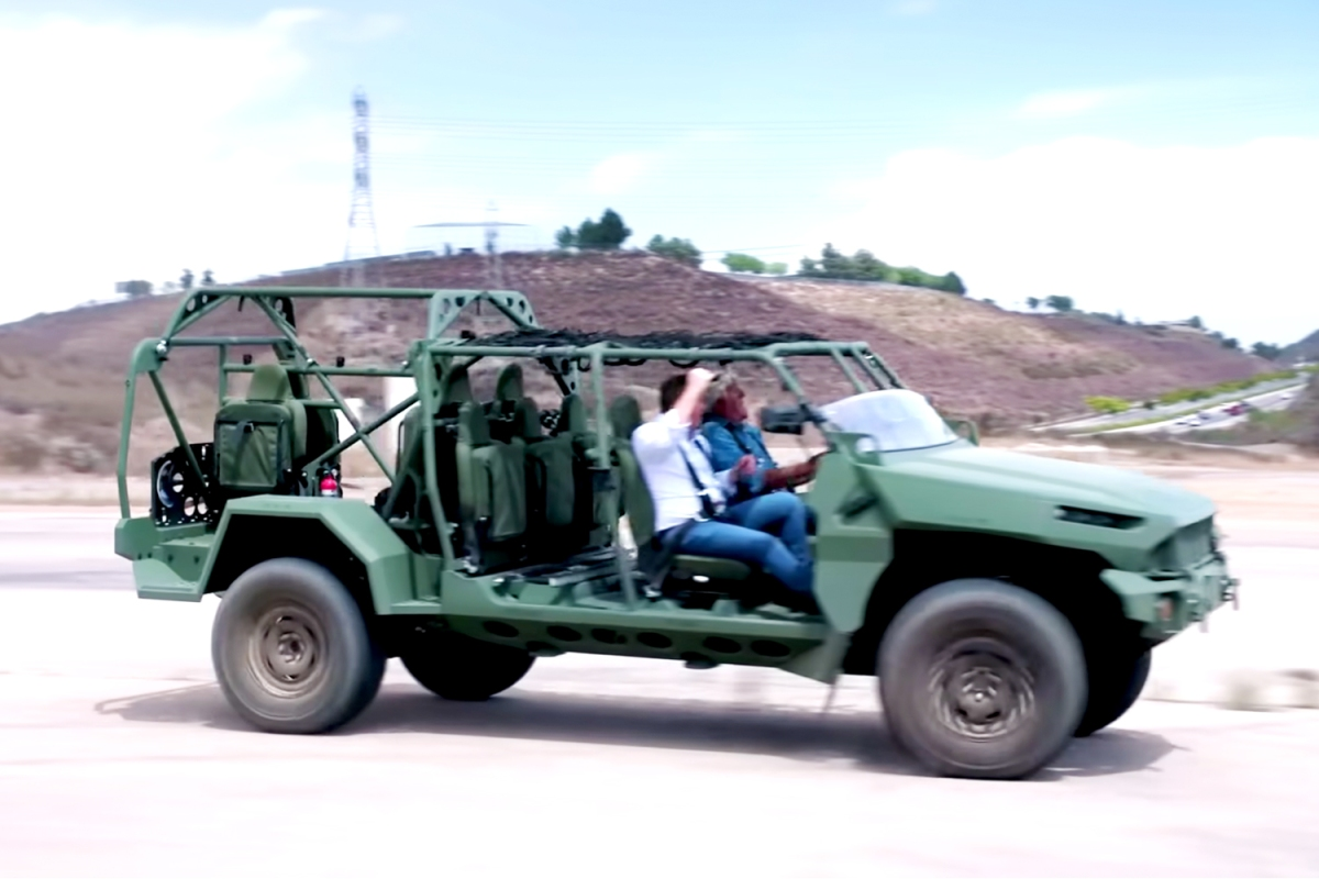 Jay Leno driving and GM Defense President Steve duMont riding in a military ISV version of the Chevy Colorado ZR2 off-road pickup truck