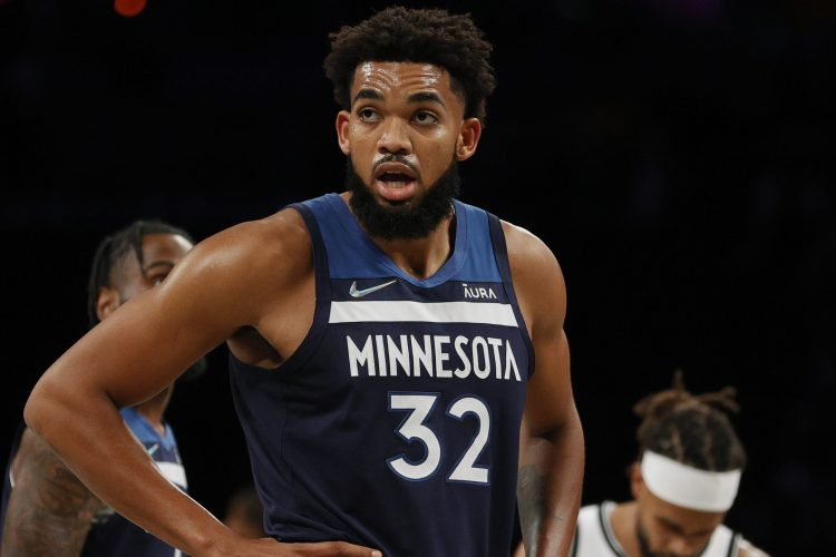 Karl-Anthony Towns of the Minnesota Timberwolves on the floor. Towns watches gorilla fights before NBA games.
