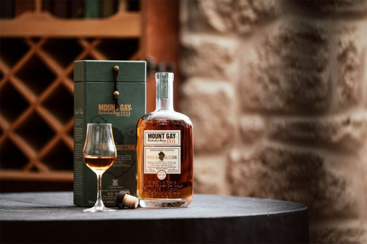 Mount Gay Master Blender Collection Andean Oak Cask, with a glass of rum. The rum is new and limited edition.