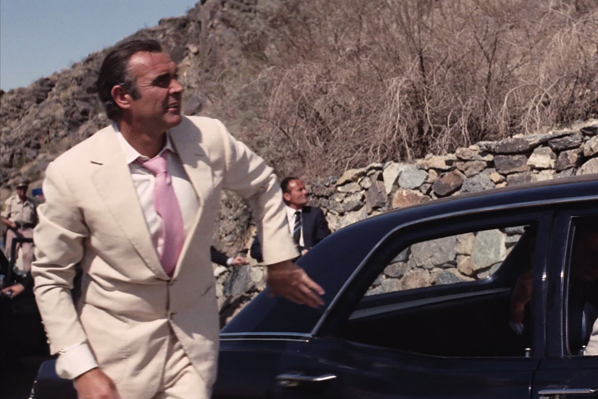 Sean Connery rocks a tan suit in Diamonds are Forever.