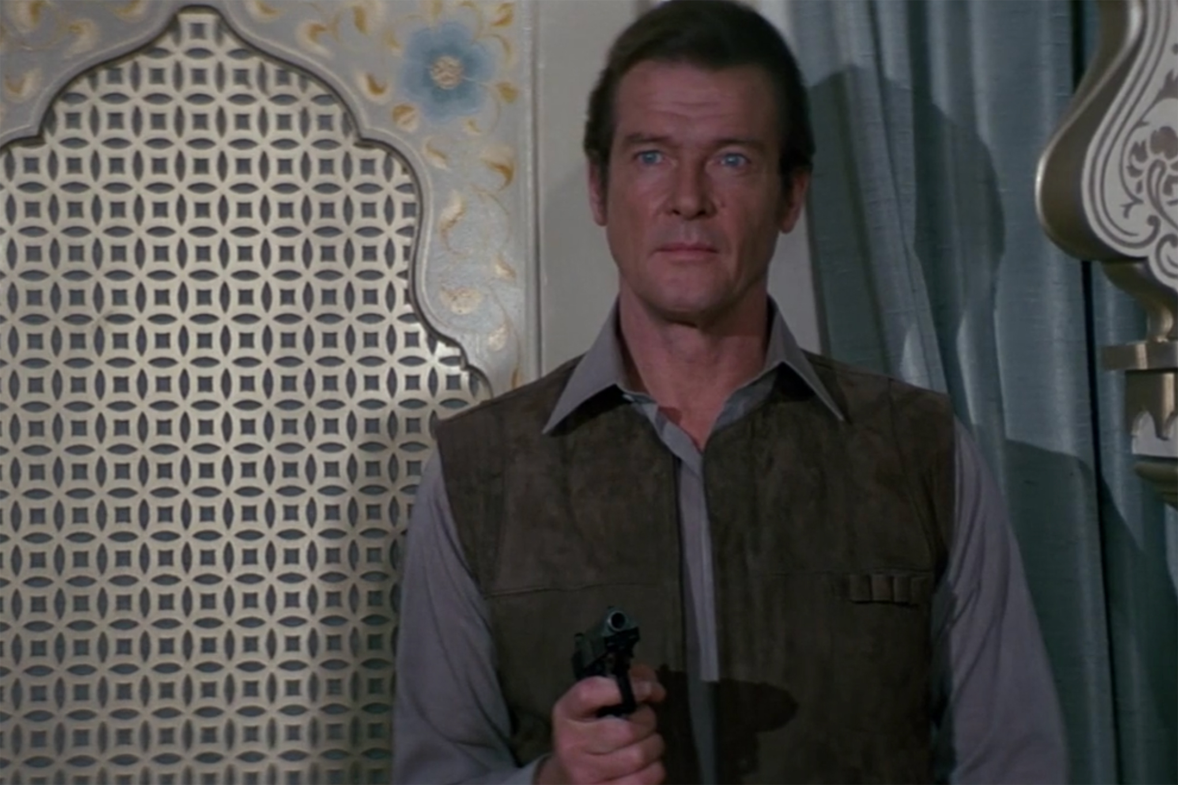Roger Moore in a simple grey button down in Octopussy.
