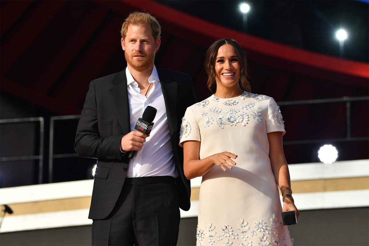 Prince Harry and Meghan Markle, the Duke and Duchess of Sussex, holding microphones onstage at Global Citizen Live on September 25, 2021 in New York City