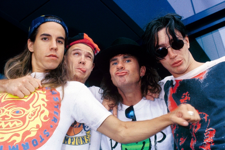 The Red Hot Chili Peppers pose for a goofy photo in the February 1990