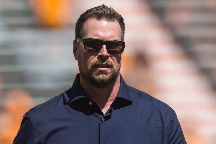 Ex-QB Ryan Leaf walking off the field before a college football game