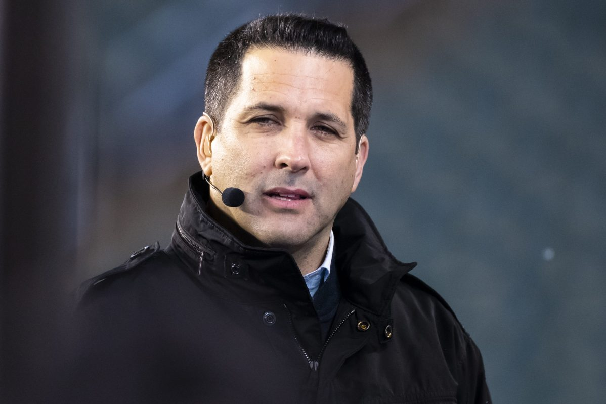 ESPN analyst Adam Schefter at Lincoln Financial Field in 2019. The ESPN reporter is under fire for leaked emails that suggest he got editorial assistance from an NFL owner.