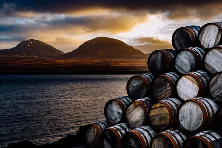 Looking towards the Paps of Jura, on the island of Jura, from Islay on a winter's morning. A new report suggest climate change could have adverse affects on Scotch.