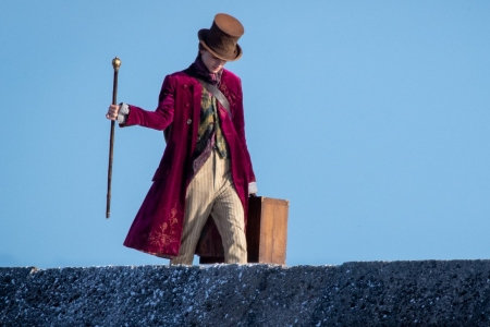 """Timothée Chalamet is seen as Willy Wonka during filming for the Warner Bros and the Roald Dahl Story Company's upcoming movie 'Wonka' on October 11, 2021, in Lyme Regis, England. This film will focus on the young Willy Wonka on his earliest adventure and how he met the Oompa-Loompas. Some critics contend Chalamet is too """"hot"""" to play Wonka"""