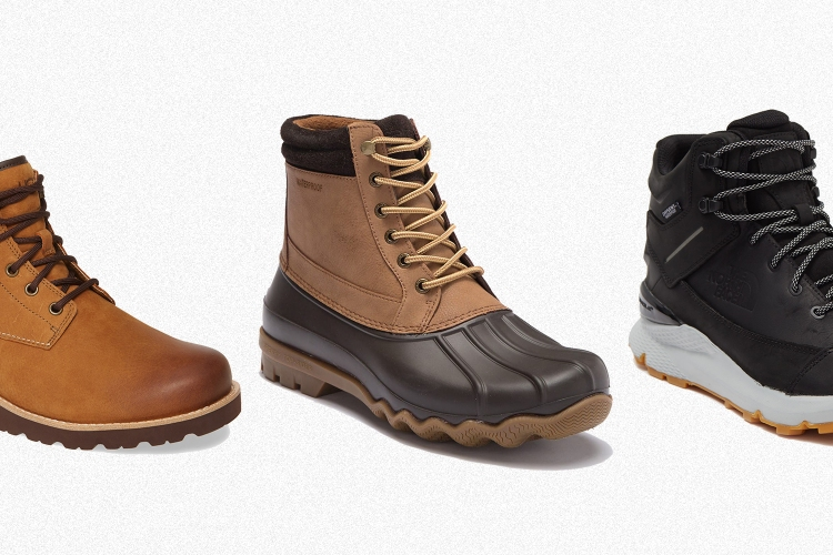 Waterproof boots from Ugg, Sperry and The North Face in a line on a grey background