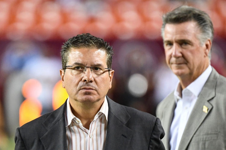 WFT owner Dan Snyder paces the sidelines in front of former general manager Bruce Allen at a game against the Chicago Bears in 2019